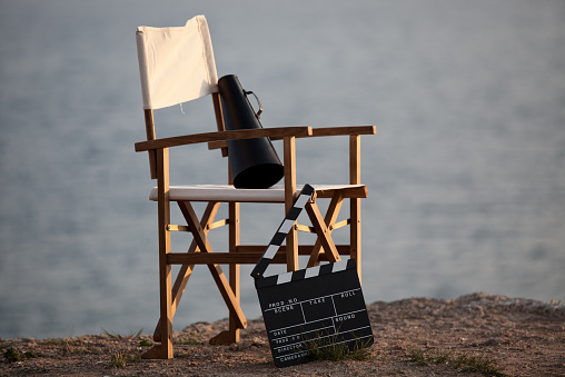 City Of Los Angeles「Director's chair in outdoor with megaphone and film slate.」:スマホ壁紙(9)