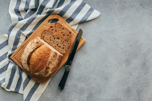 Bakery「Freshly Baked Bread on Wooden Table」:スマホ壁紙(18)