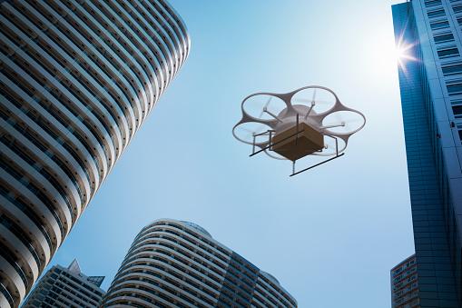 無人操縦機「Delivery drone flying above high rise apartments」:スマホ壁紙(13)