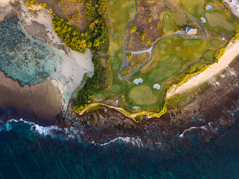 Sand Trap「Indonesia, Bali, Aerial view of golf course with bunker and green at coast」:スマホ壁紙(3)