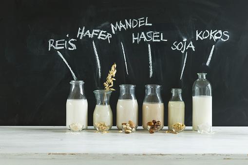Side By Side「Glass bottles of various vegan milks」:スマホ壁紙(18)