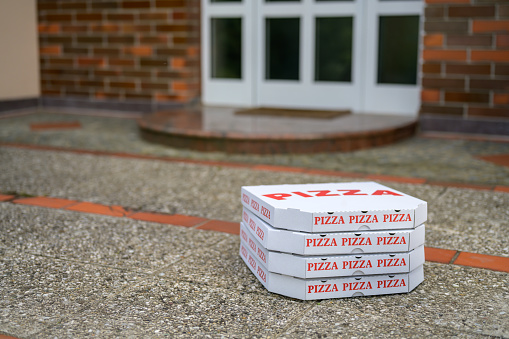 Quarantine「Pizza boxes on the floor in front of a door of a house」:スマホ壁紙(16)