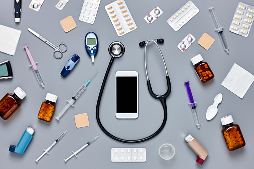 Mobile Phone「Flat lay of smart phone surrounded with various medical equipmen」:スマホ壁紙(13)