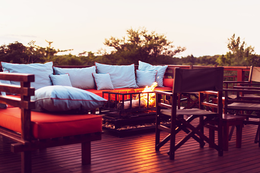 Chalet「Romantic Setting on a Wooden Deck with Fireplace and Outdoor Furniture at a Holiday Resort in Africa」:スマホ壁紙(4)