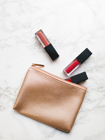 Girly「Lip glosses and purse on marble background」:スマホ壁紙(16)