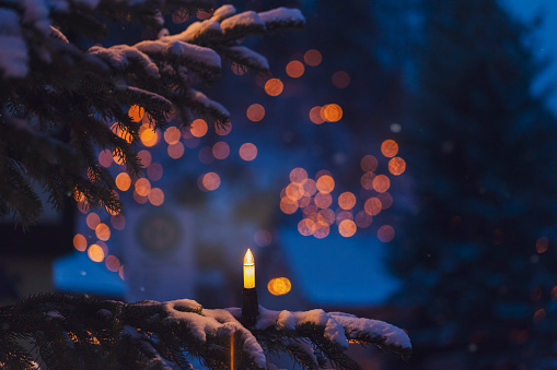 Christmas Decoration「Lighted electric candle on snow-covered fir branch」:スマホ壁紙(3)