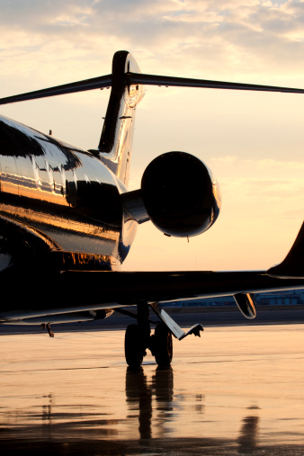 Commercial Airplane「Backside of Private Jet on Tarmac at Dusk」:スマホ壁紙(10)