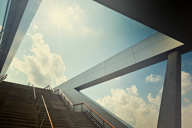 A stairway leading up to blue sky with sun over light cloud:スマホ壁紙(壁紙.com)