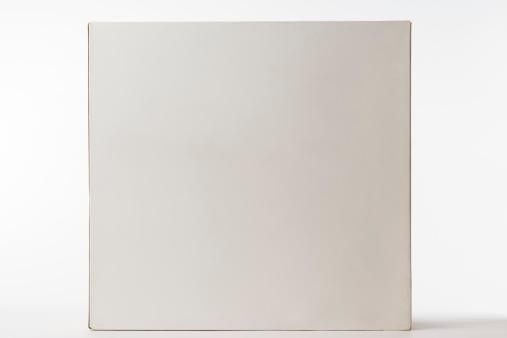 Cardboard「Isolated shot of closed blank cube box on white background」:スマホ壁紙(9)