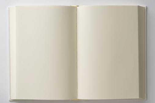 Looking Down「Isolated shot of opened blank white book on white backgrounds」:スマホ壁紙(9)