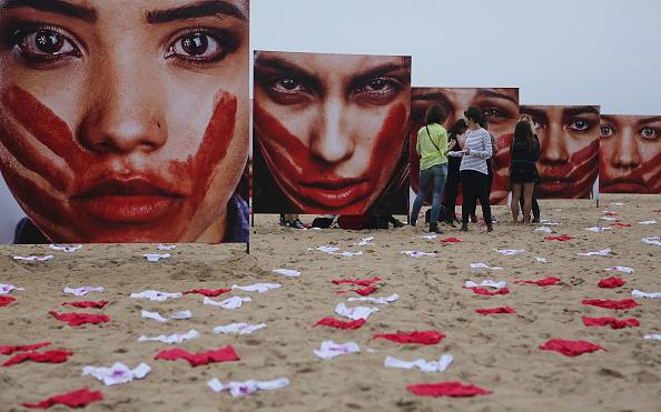 Violence「Activists Protest Violence Against Women In Rio De Janeiro」:写真・画像(8)[壁紙.com]