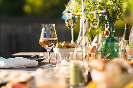 Swedish Culture「Glass of Rosé Wine at Midsummer Dinner」:スマホ壁紙(19)