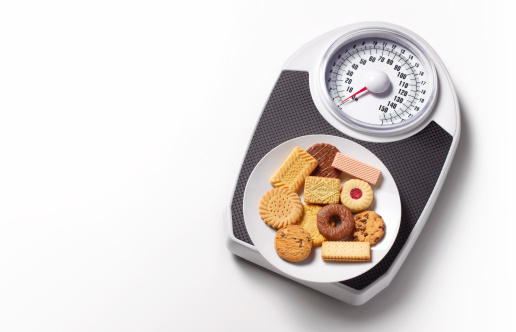 Unhealthy Eating「Biscuits on bathroom scales with copy space」:スマホ壁紙(18)