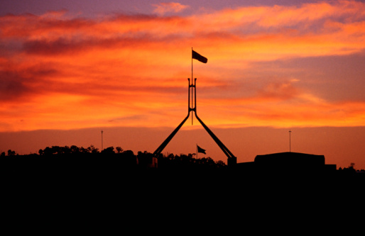 Politics「Parliament House flag silhouetted at sunset.」:スマホ壁紙(10)