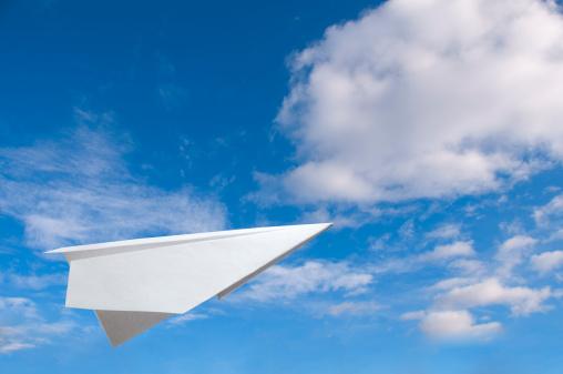 Meteorology「Paper plane flying in the air against a blue sky」:スマホ壁紙(18)