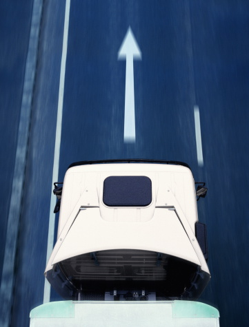 Approaching「Lorry driving over arrow sign on road,overhead view (blurred motion)」:スマホ壁紙(1)