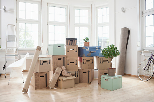 Moving House「Stack of cardboard boxes in empty apartment」:スマホ壁紙(14)