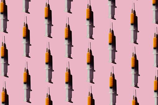 Conformity「3D Illustration of syringes, pink background」:スマホ壁紙(1)