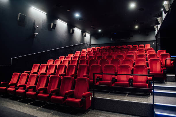 Empty rows of red seats:スマホ壁紙(壁紙.com)