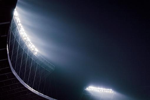 Floodlight「Stadium lights glowing against night sky」:スマホ壁紙(2)
