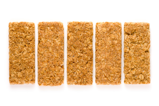 Granola「Crunchy oat granola bars isolated on a white background」:スマホ壁紙(1)