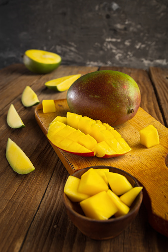 Orange Color「Fresh juicy cutting mango on a wooden table」:スマホ壁紙(3)