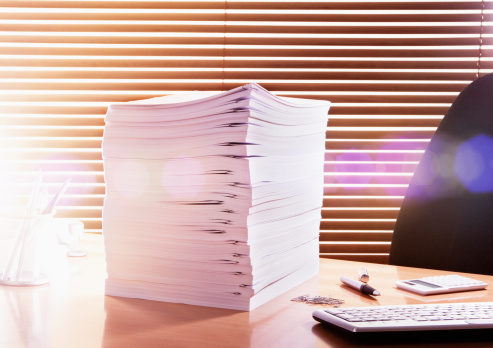 Emotional Stress「Large pile of documents on office desk.」:スマホ壁紙(12)