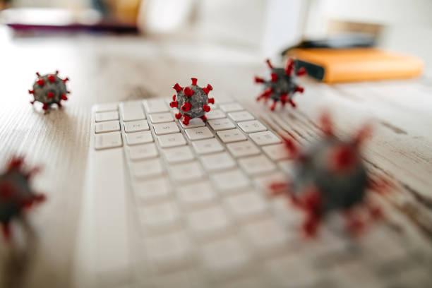 Model of corona virus on desk and keyboard in office:スマホ壁紙(壁紙.com)