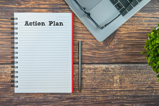 Kota Kinabalu「Action Plan words typed on notepad with laptop and pen. Concepts with wooden background.」:スマホ壁紙(10)