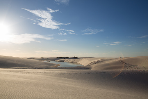 Standing Water「Golden dunes at the sunset of the lençois maranhenses with a photo flare」:スマホ壁紙(5)