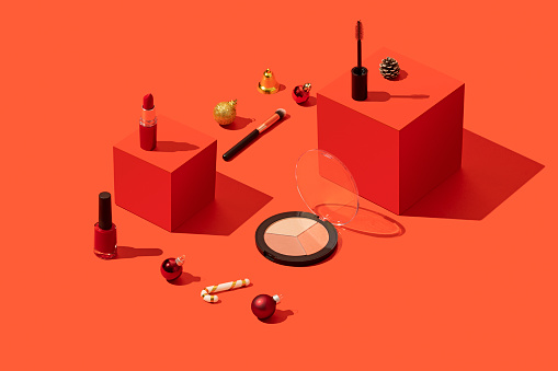 Colored Background「Makeup, cosmetics on red Christmas background with red cubes」:スマホ壁紙(18)