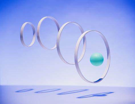 Success「Green ball going through hoops」:スマホ壁紙(4)