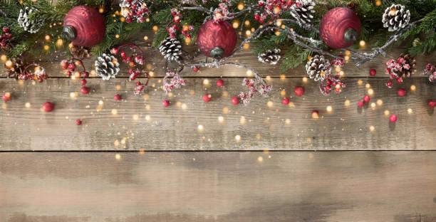 Christmas ornament and garland background on wood:スマホ壁紙(壁紙.com)