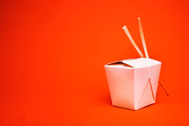 Chinese takeout container with chopsticks, isolated on red:スマホ壁紙(壁紙.com)