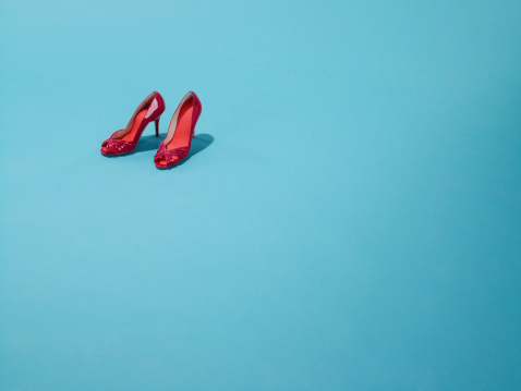 Colored Background「Red shoes sit on a blue backdrop」:スマホ壁紙(2)