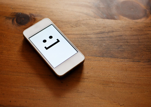 Mobile Phone「Smartphone with emoticon smile face」:スマホ壁紙(13)