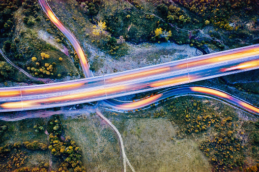 Light Trail「Highway viaduct over a curving country road in woody area」:スマホ壁紙(10)