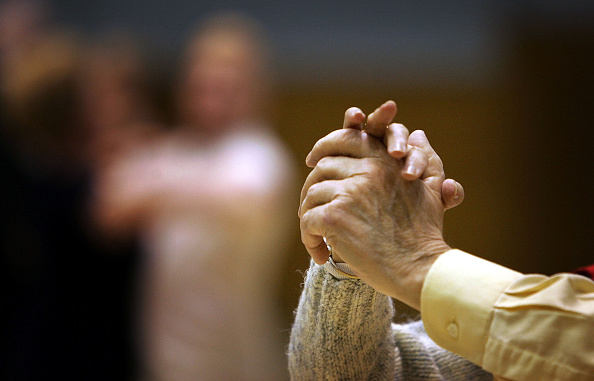 Holding「Pensioners In Scotland Take Part In A Local Tea Dance」:写真・画像(14)[壁紙.com]
