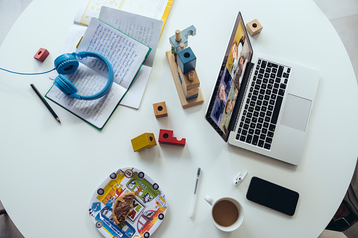 Adult「Laptop on dining table with building blocks, exercise books  and dishes」:スマホ壁紙(11)