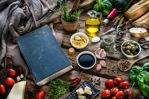 Recipe「Mediterranean ingredients, spices and cookbook on rustic table」:スマホ壁紙(13)