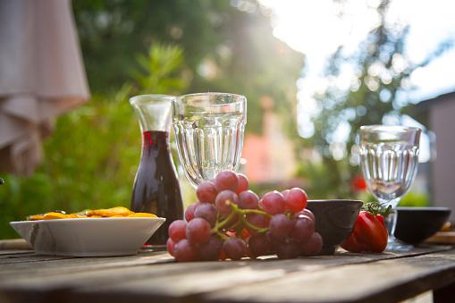 Appetizer「Mediterranean antipasti and wine on garden table」:スマホ壁紙(6)