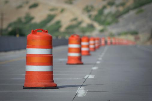Road Construction「Orange and white construction cones closing a road Lane」:スマホ壁紙(14)