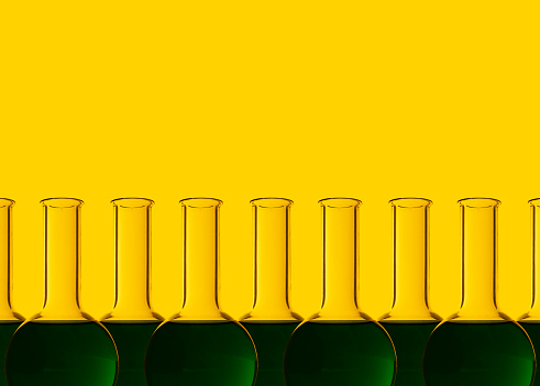 Chemical「Row of test tubes with liquid, yellow background」:スマホ壁紙(3)