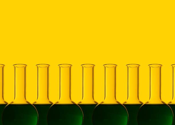 Row of test tubes with liquid, yellow background:スマホ壁紙(壁紙.com)