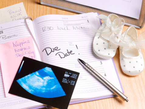 Diary「Diary and pen on desk with baby booties, high angle view」:スマホ壁紙(14)