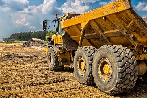 Construction Vehicle「The yellow dump truck on the construction of highway S6, Goleniów, Poland」:スマホ壁紙(19)