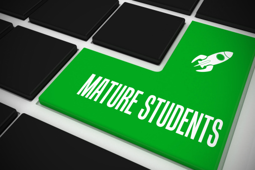 University Student「Mature students on black keyboard with green key」:スマホ壁紙(5)