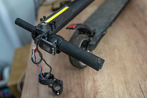 Soldered「Repairing electrical scooter in special workshop.」:スマホ壁紙(4)