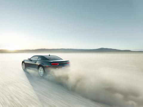 Dust「Black sports car driving on dry lake bed」:スマホ壁紙(3)