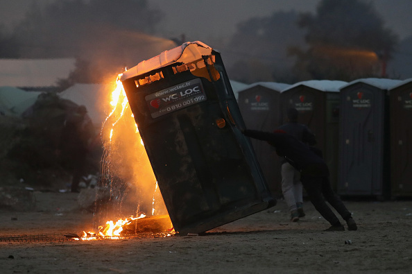 Calais「Migrants Leave The Jungle Refugee Camp In Calais」:写真・画像(13)[壁紙.com]